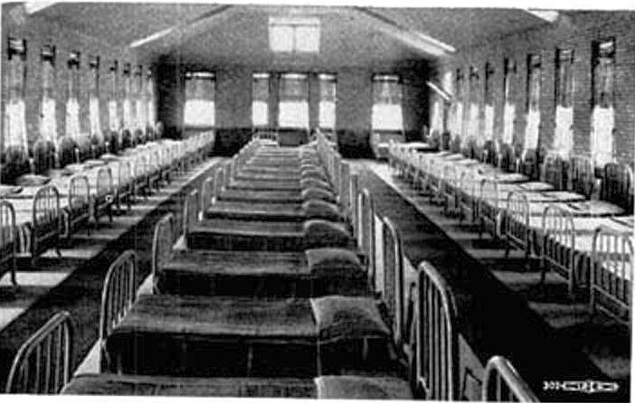 Black and white photo of an empty aslyum ward